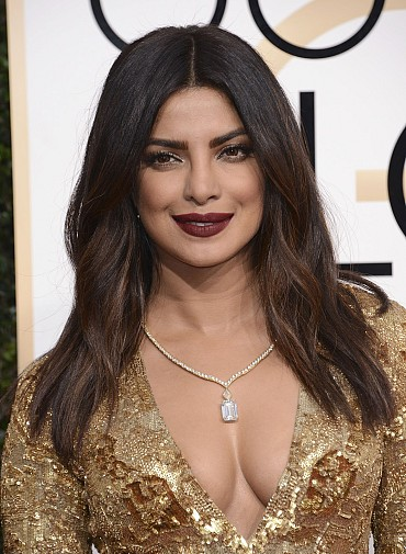Priyanka Chopra Sexy Cleavage Show At The 74th Annual Golden Globe Awards At The Beverly Hilton Hotel In Beverly Hills