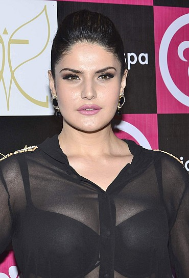 Zarine Khan Flashes Her Black Bra And Sexy Curves From A See-through Top At The Launch Of 'MicroSpa' In Bandra, Mumbai